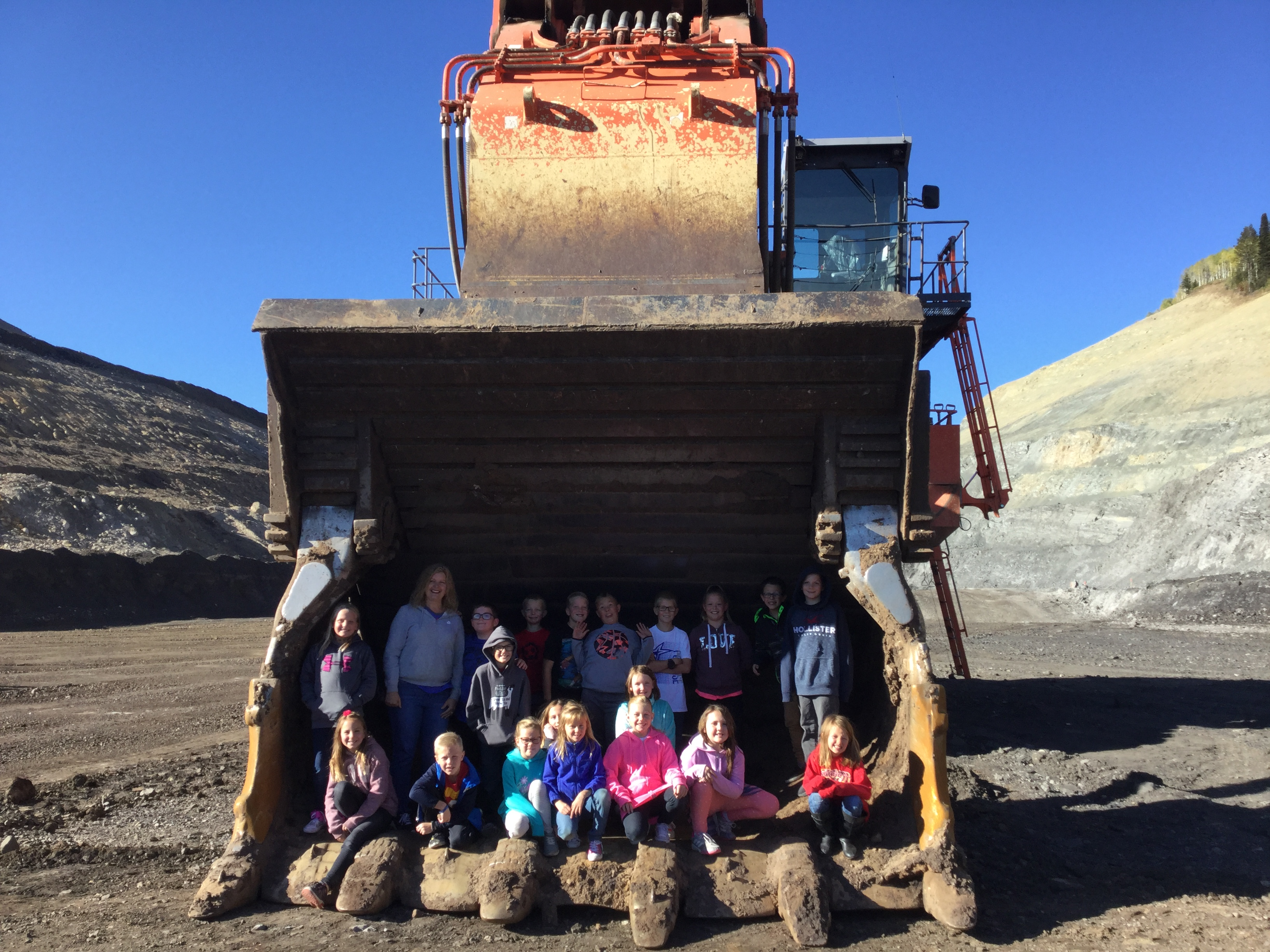 Mrs. Carlisle's class on their fieldtrip to Smokey Canyon Mine in the mouth of a dozer.