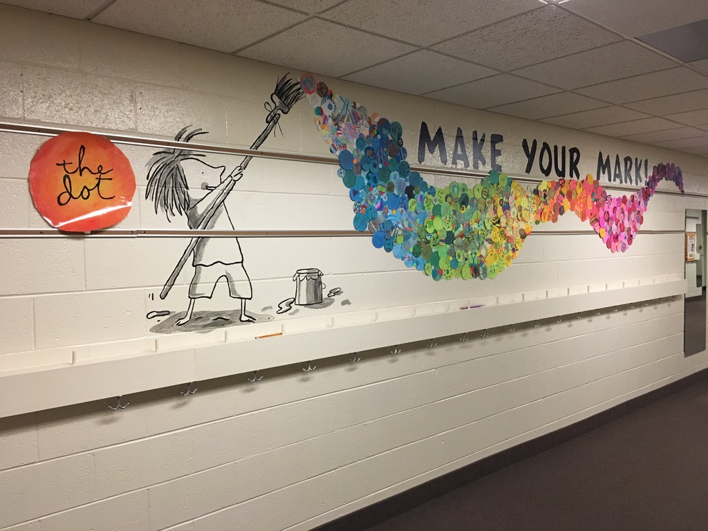 Picture of mural on wall for library theme of Make Your Mark, based off of a book called The Dot.